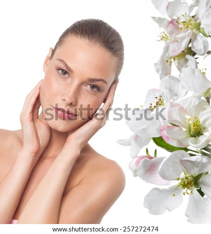 closeup portrait of attractive  caucasian smiling woman brunette isolated on white studio shot lips  face  head and shoulders looking at camera spring flowers - stock photo