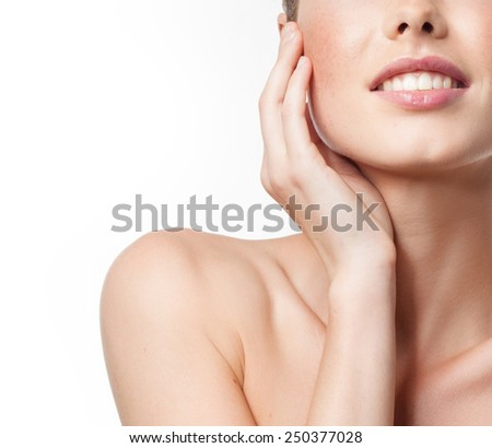 closeup portrait of attractive  caucasian smiling woman isolated on white studio shot lips toothy smile face hand tooth  - stock photo