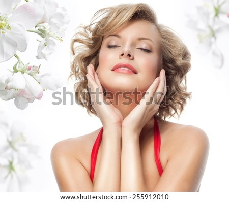 closeup portrait of attractive  caucasian  woman blond isolated on white studio shot lips  face hair head and shoulders  eyes closed spring flowers - stock photo