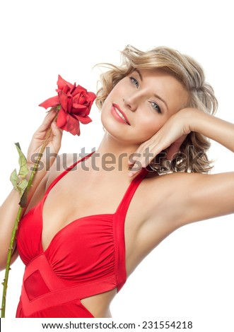 closeup portrait of attractive  caucasian  woman blond isolated on white studio shot lips face hair head and shoulders looking at camera blue eyes tooth red rose flower aroma - stock photo