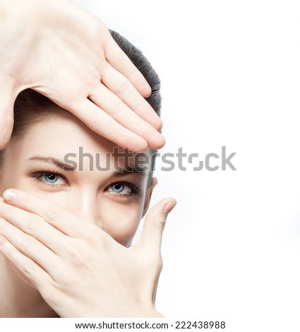 closeup portrait of attractive  caucasian  woman brunette isolated on white studio shot  face hair head  looking at camera hands eyes focus - stock photo