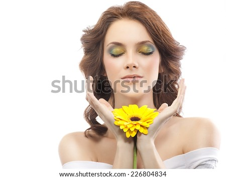 closeup portrait of attractive  caucasian woman brunette isolated on white studio shot lips  face hair head and shoulders skin makeup yellow flower aroma spring summer eyes closed - stock photo