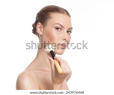 closeup portrait of attractive  caucasian  woman brunette isolated on white studio shot lips  face  head and shoulders looking at camera makeup brush - stock photo