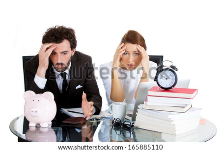 Closeup portrait of attractive couple, handsome man, beautiful woman, looking distressed from financial problems, mounting bills, isolated on white background. Good, bad finance decision. Bank mistake - stock photo