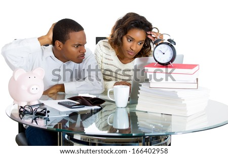 Closeup portrait of attractive couple, man and woman, looking distressed from financial problems and mounting bills, isolated on white background. Good and bad finance  - stock photo
