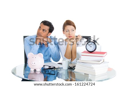 Closeup portrait of attractive couple, man and woman, looking stressed from financial problems and mounting bills and marriage difficulties, isolated on white background. Human emotions, expressions - stock photo