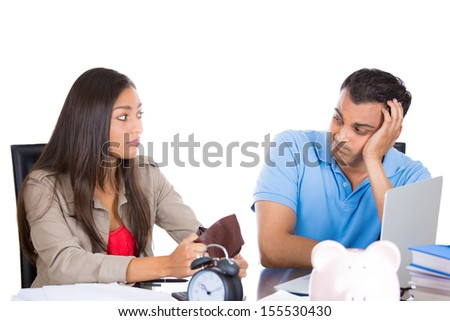 Closeup portrait of attractive couple, woman upset because she has no money in wallet and guy depressed because he is broke, isolated on white background - stock photo