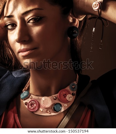 Closeup portrait of attractive female wearing stylish accessories, fashionable makeup, gorgeous jewelery, elegant look, vogue concept - stock photo