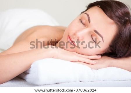 Closeup portrait of attractive gentle female enjoying day spa in luxury beauty salon, alternative medicine, harmony and inner peace concept - stock photo