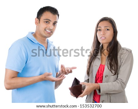 Closeup portrait of attractive man and woman couple showing empty wallet, being broke and poor, isolated on white background - stock photo