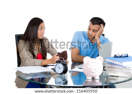 Closeup portrait of attractive man and woman showing empty wallet to her husband, being broke and poor, isolated on white background. FInancial difficulties, job loss, mortgage payment problem - stock photo