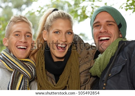 Closeup portrait of attractive smiling young people outdoors. - stock photo