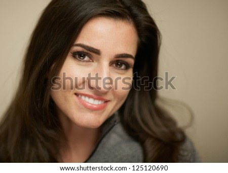 Closeup portrait of attractive smiling young woman - stock photo