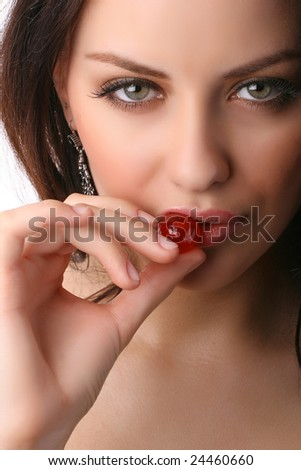closeup portrait of attractive woman holding berry isolated on white - stock photo