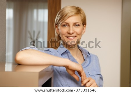 Closeup portrait of attractive young blonde woman smiling. - stock photo