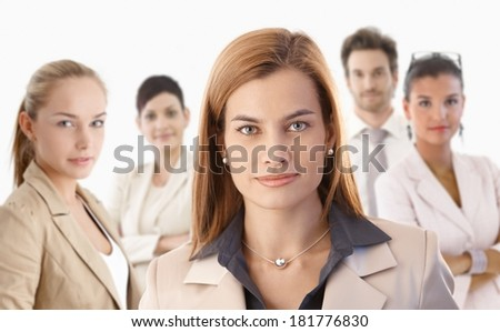 Closeup portrait of attractive young businesswoman and colleagues over white background.