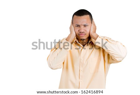 Closeup portrait of attractive young man covering his ears, closing his eyes, isolated on white background with copy space. Hear no evil concept. Human emotions, expressions and communication signs - stock photo