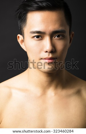 Closeup portrait of attractive young man face