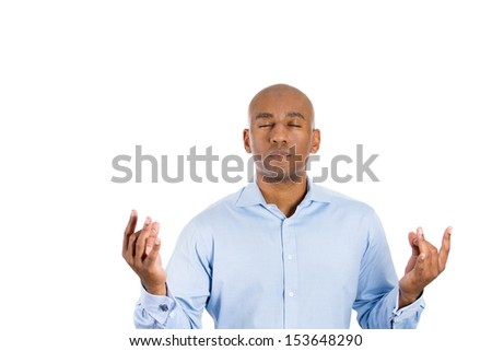 Closeup portrait of bald male, handsome businessman with blue shirt in meditation pose, relaxing, in zen, isolated on white background with copy space - stock photo