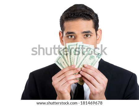 Closeup portrait of banker, executive, ceo, business man, corporate employee hiding behind currency bills, peeking above with eyes, isolated on white background. Financial expressions, emotions - stock photo