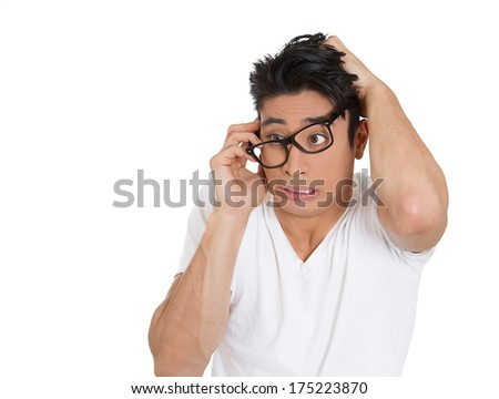 Closeup portrait of bashful nervous young man with big black glasses cowering in fear, isolated on white background. Negative emotion facial expression feelings, situation, reaction, body language - stock photo