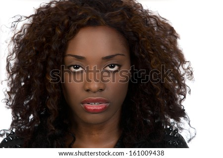Closeup portrait of beautiful African American woman over white background. - stock photo