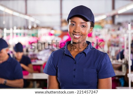 closeup portrait of beautiful african textile worker in factory