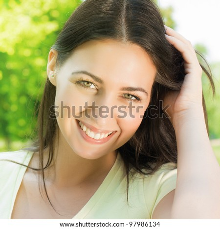 Closeup portrait of beautiful and happiness young woman.