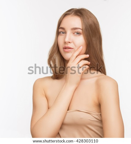 Closeup portrait of beautiful and pretty model lady posing for photographer over white background in studio. Woman with brown hair posing for fashion beauty magazine.