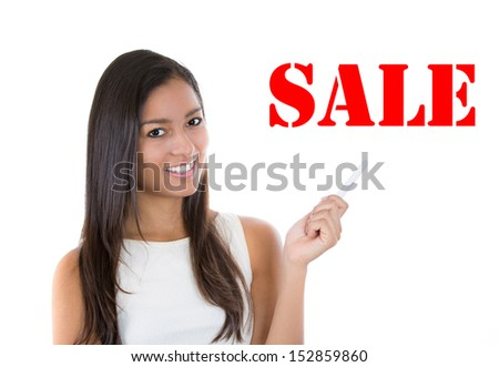 Closeup portrait of beautiful, attractive female pointing to red sale sign, isolated on white background