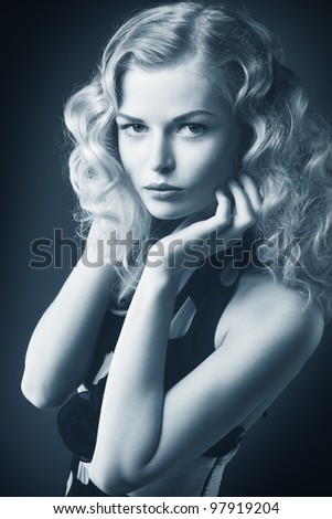 Closeup portrait of beautiful blond woman with gold hair