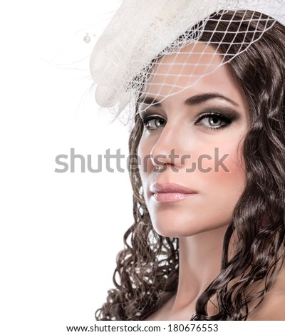 Closeup portrait of beautiful bride isolated on white background, gorgeous model wearing stylish hat with gentle veil, retro bridal look concept