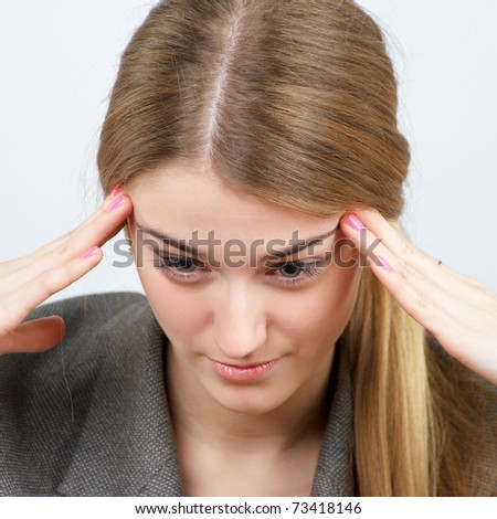 Closeup portrait of beautiful businesswoman trying to focus on work - stock photo