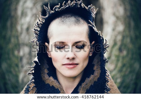 Closeup portrait of beautiful Caucasian white young bald girl woman with shaved hair head with closed eyes, head covered with scarf shawl, spiritual mood state of mind, conceptual, peaceful warrior - stock photo
