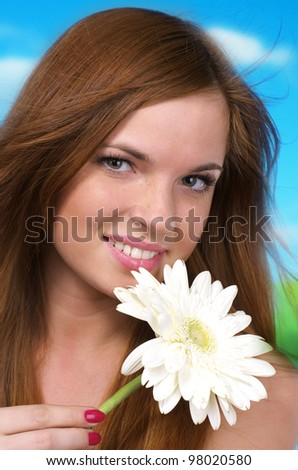 Closeup portrait of beautiful Caucasian woman with white flower - stock photo