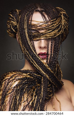 Closeup portrait of beautiful caucasian young woman with many african braids - stock photo