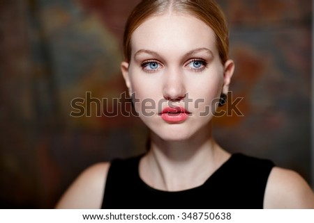 Closeup portrait of beautiful cold looking woman in makeup. - stock photo