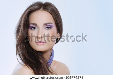 Closeup portrait of beautiful elegant woman with health skin and violet color makeup - stock photo
