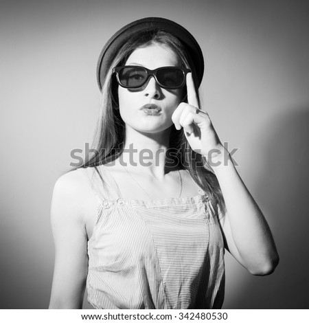 Closeup portrait of beautiful exciting young lady in glasses. Black and white photography - stock photo
