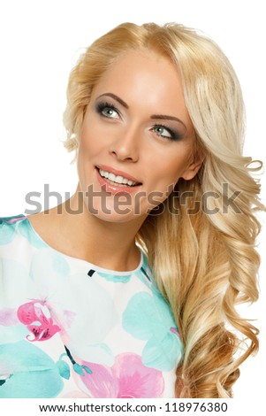 Closeup portrait of beautiful female with strong long blond hair