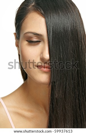 Closeup Portrait of beautiful girl with dark long hair.