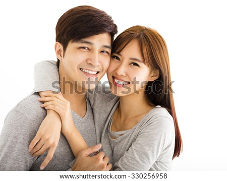 Closeup portrait of beautiful happy couple - stock photo