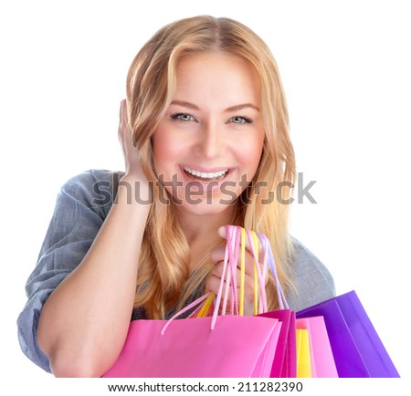 Closeup portrait of beautiful happy girl with colorful shopping bag isolated on white background, season sales concept - stock photo