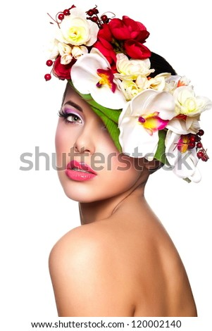closeup portrait of beautiful sexy brunette caucasian young woman model with glamour lips,bright makeup. With colorful flowers on head - stock photo