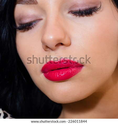 closeup portrait of beautiful sexy young lady with red lipstick relaxing eyes closed - stock photo