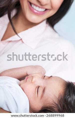 Closeup portrait of beautiful sleeping baby on mothers hands, enjoying motherhood, young happy family, love concept - stock photo