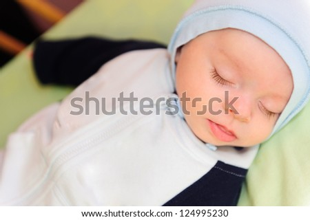 Closeup portrait of  beautiful sleeping newborn baby - stock photo
