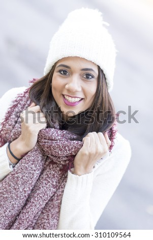 Closeup portrait of beautiful woman, autumn and winter style.