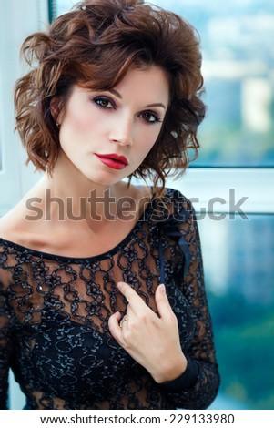 Closeup portrait of beautiful woman in black bodysuit - stock photo