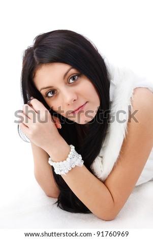 Closeup portrait of beautiful woman lying down on floor - stock photo